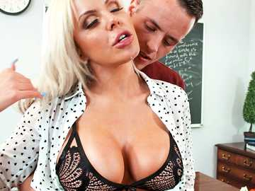 Hot German teacher Nina Elle gives her student titty fucking in class